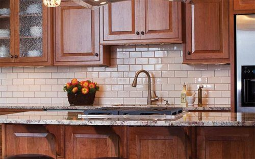 cream colored subway tile backsplash for the home