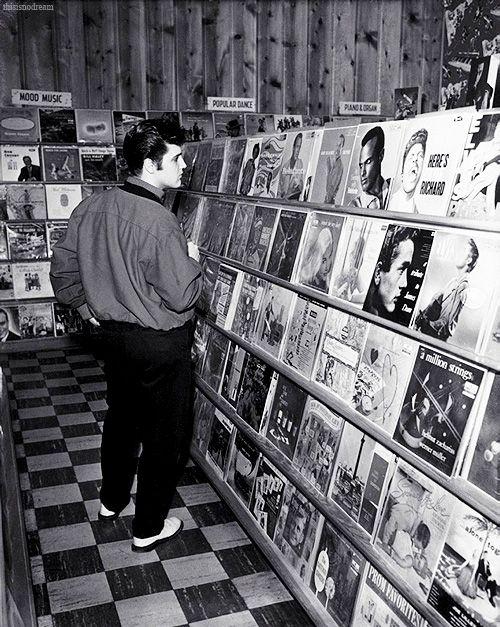 Elvis Presley in a Memphis record shop, 1957.