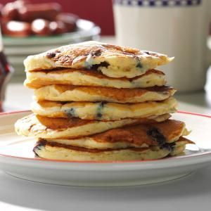 Dad's Blueberry Buttermilk Pancakes Recipe -My dad makes blueberry pancakes for us every Saturday without fail. The combination of oats, cornmeal and buttermilk in the batter gives the pancakes heartiness we can't resist. —Gabrielle Short, Pleasant Hill, Iowa