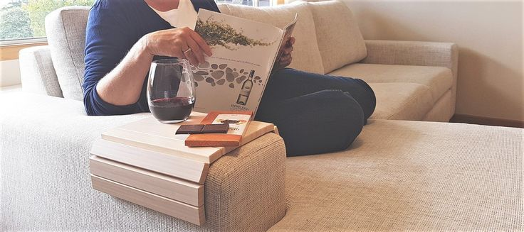 Slinky Sofa Tables | Their mantra, 'probably the most useful product you'll ever own' rings true for their ingenious invention. Made of bamboo and very well priced, this versatile product will look great in most any interior theme. #slinkysofatable #sofahuggingtable #sofatable #table #christmasgiftidea #woodentable #furniture #spacesaver #interiors