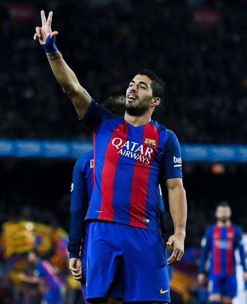 Luis Suarez of FC Barcelona celebrates after scoring his team's first goal during the La Liga match between FC Barcelona and RCD Espanyol at the Camp Nou stadium on December 18, 2016 in Barcelona, Catalonia.
