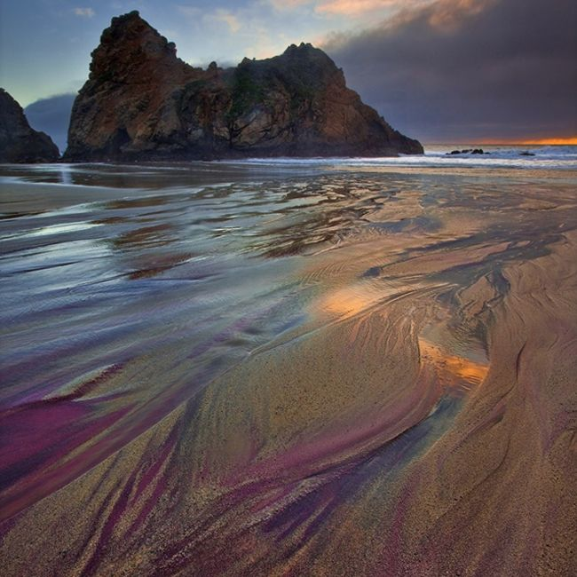 The exotic purple sands of the Pfeiffer Beach (near California's Pfeiffer Big Sur State Park) draw their unusual color from manganese garnet granules eroded from deposits littered throughout the region.