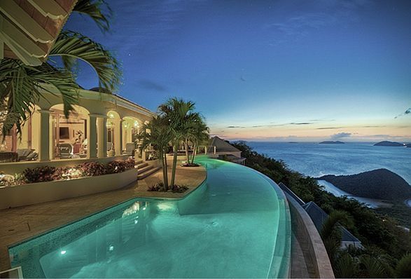 The breathtaking Celestial House is perched right on top of a hill located in the West End of the British Virgin Islands, with a stunning secluded setting and natural, awe-inspiring, surroundings. The unique property features an expansive wrap-around