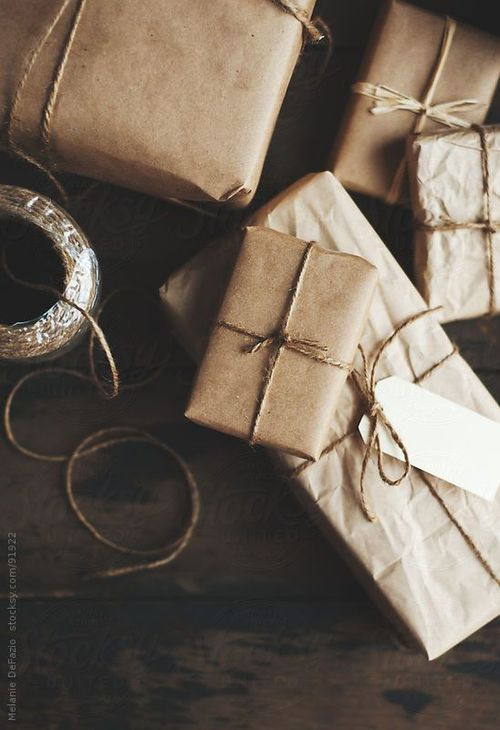 great simple wrapping twine or raffia.....I use this often adding a touch of nature ie: real leaves, attaching a small pine cone etc  Just Get creative