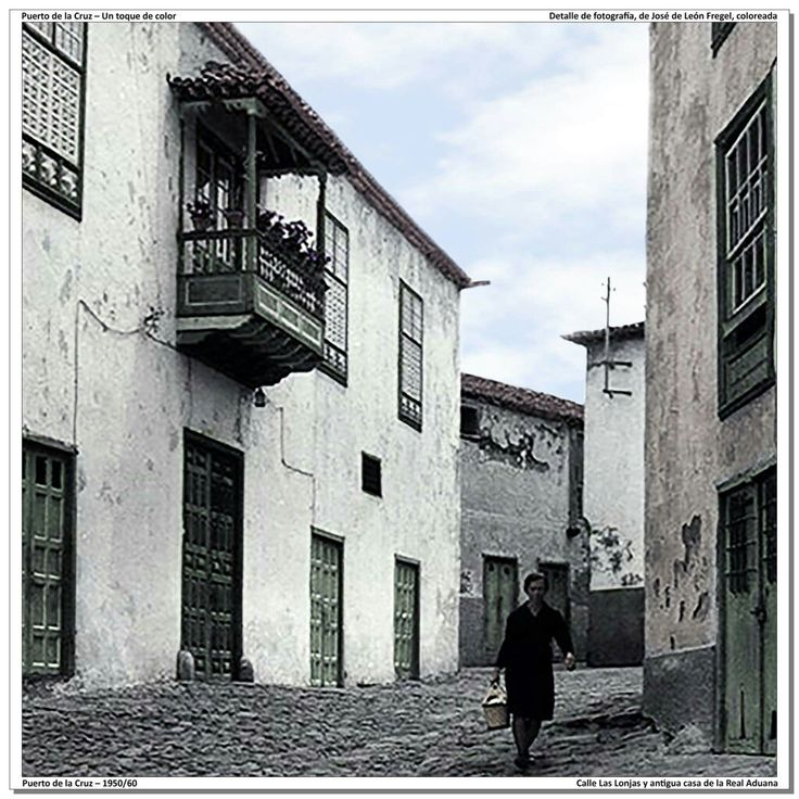 Puerto de la Cruz – 1950/60 Calle Las Lonjas y antigua casa de la Real Aduana [Detalle de fotografía, de José de León Fregel, coloreada] La pequeña calle Las Lonjas debe su nombre a que en ese lugar se ubicaron la mayoría de las lonjas de pescado que existían en el municipio.