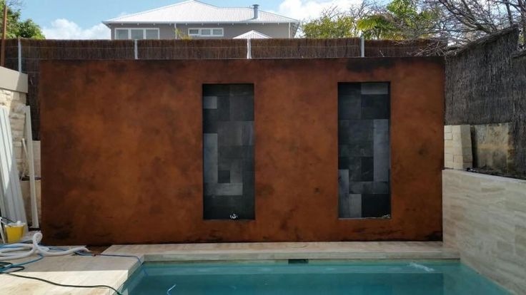 Porters Paints Liquid Iron & Instant Rust by Painted Earth. A stunning back drop giving great ambience to a beautiful pool.