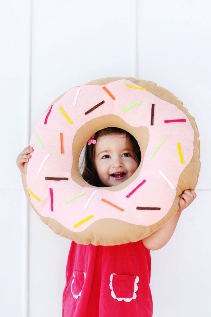 Simple donut pillow tutorial from A Beautiful Mess - for both kiddos AND grown-up kiddos! Just in time for National Donut Day. #sweettooth #donuts