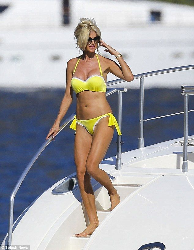 Showing out: Model Victoria Silvstedt flaunted her enviable figure in a canary yellow bikini on Friday as she sunned herself in the South of France