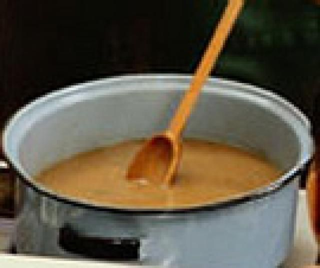 A Simple Recipe for Basic Vegetarian Gravy: Stirring the gravy. I love this gravy. I puree the gravy so SG doesn't see the onion.