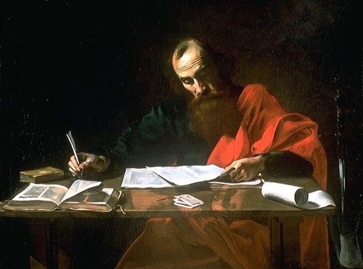 The Apostle Paul writing the epistles.
