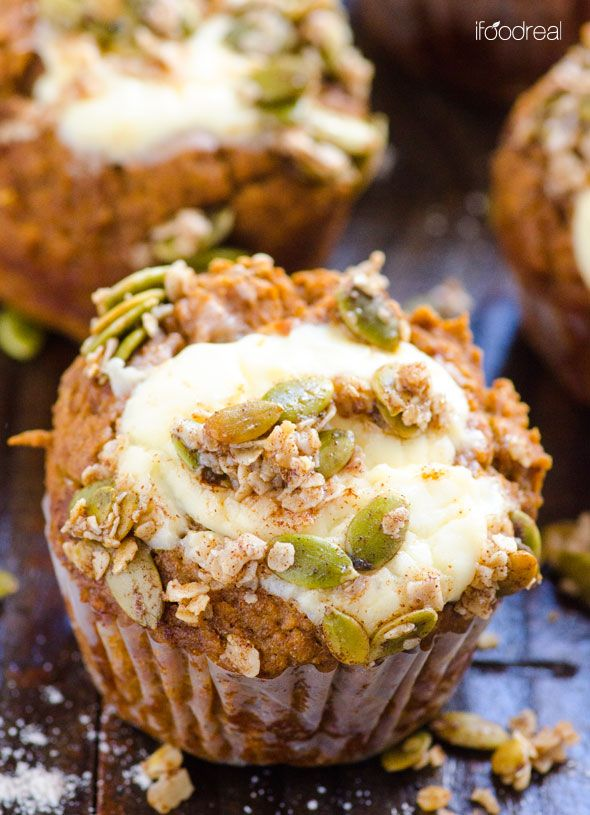 Spelt Pumpkin Cream Cheese Muffins -- 100% spelt, sweetened with dates, filled with light organic sweet cream cheese and topped with out of this world cinnamon pepita crumb topping.