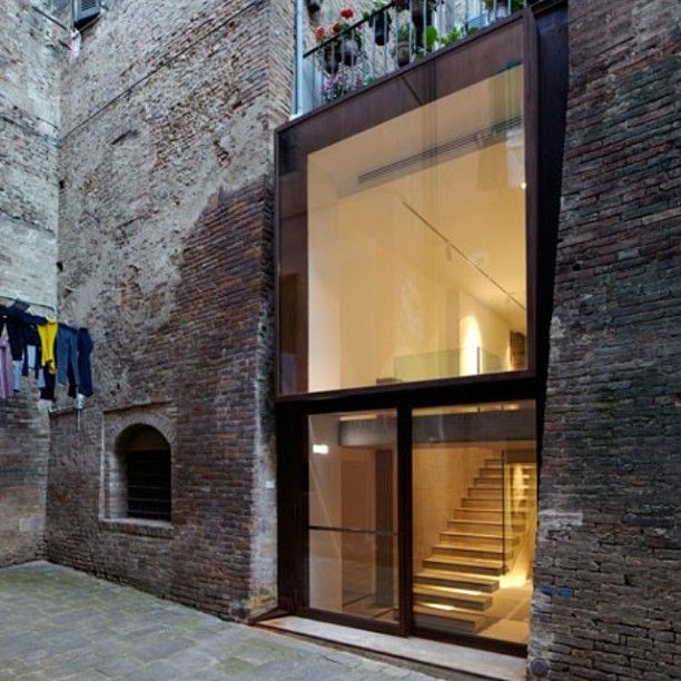 Old and new coming together in Sienna, Italy. Old brick structure. New beautifully detailed glass and steel infill.
