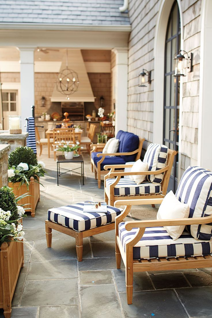 Outdoor terrace with cabana striped patio cushions, from Ballard Designs. Hubby is a professional carpenter and is building us the seating. I am looking for cushions, and stripes are my cup of tea!