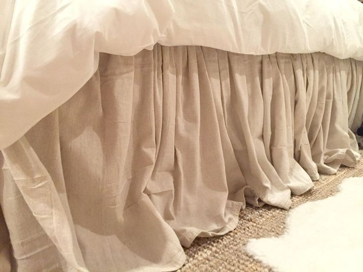 DIY No Sew Drop Cloth Bed Skirt.  I would use Velcro strip instead of tacks so it could be washed.