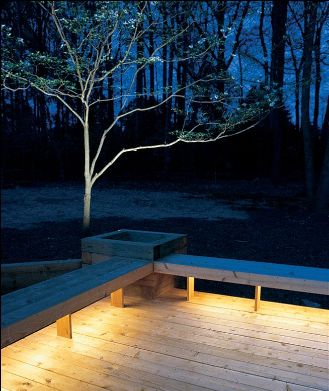 Installing lights under benches bathes your deck in a warm glow.