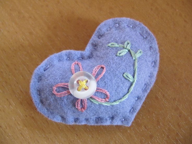 Little handmade padded felt brooch with hand stitched embroidery and button using vintage button and threads.