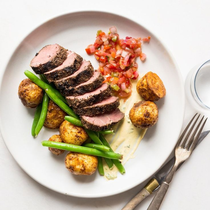 Argentinian Grilled Steak. Black Angus steak is rubbed with a brown sugar and chili spice blend, then roasted until caramelized. Thick slices of the medium-rare steak (so you can warm it up to the temp you prefer) are served with papas bravas, green beans
