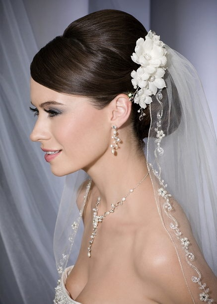 Bel Aire bridal veil and floral clip available at Cherry Blossom Bridal. Call (202) 544-2400 to schedule an appointment. #wedding #bridalaccessories #veil