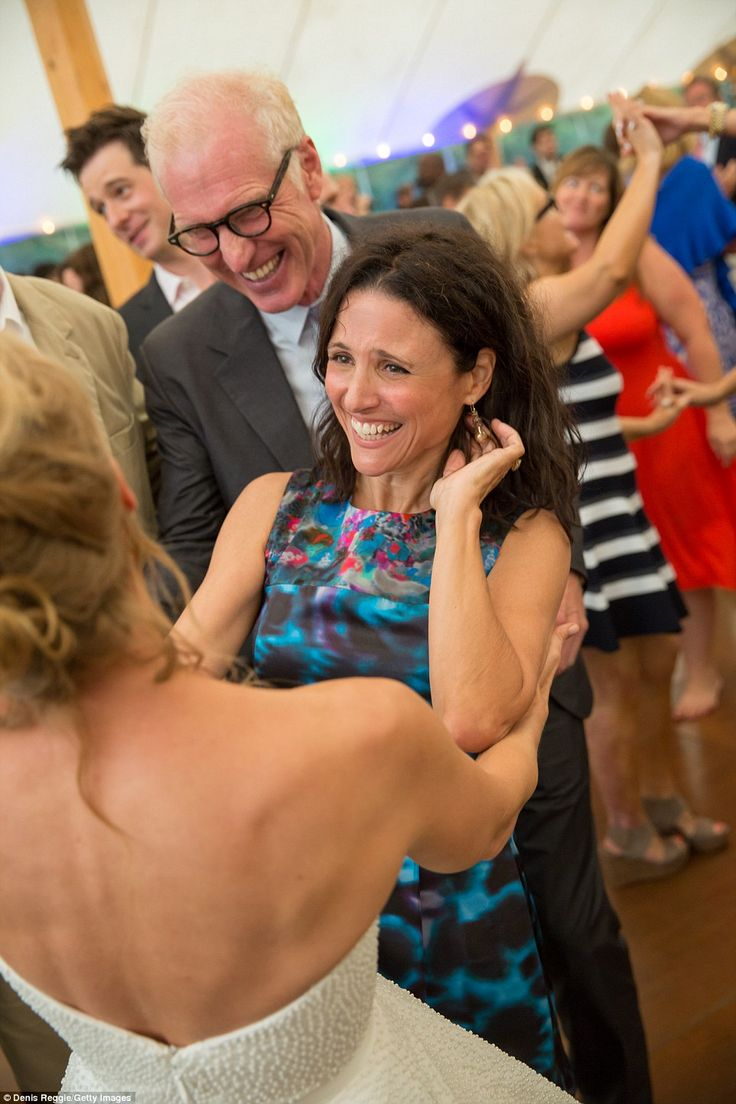 Bride meets Veep: Julia Louis-Dreyfus and her husband Brad Hall greeted Cheryl with joy after the ceremony. Louis-Dreyfus plays the vice pre...