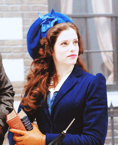 Blog on film costumes and costume design. Dracula - Jessica De Gouw as Mina Murray wearing a blue velvet coat over a blue satin blouse with white collar. The accessories include tan leather gloves and a blue beret with silver ribbon bow.