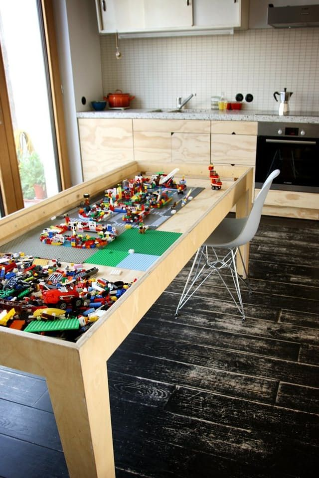 A kitchen table does double duty as a sleek way to store LEGOs.