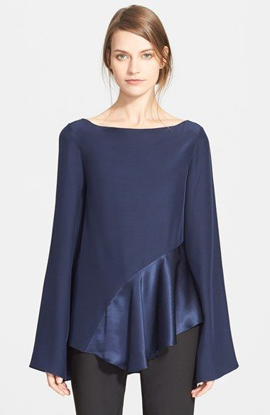 Free shipping and returns on Elizabeth and James Asymmetrical Ruffle Blouse at Nordstrom.com. A lustrous satin ruffle graces the asymmetrical hem of a fluid silk blouse styled with vintage-vibe bell sleeves and a breezy bateau neckline.