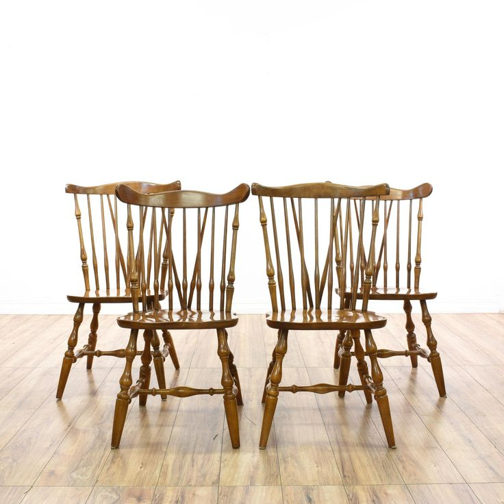 This set of 4 windsor dining chairs are featured in a solid wood with a glossy stained birch finish. These country chic dining chairs have tall spindle backs with turned wood legs and contoured seats. Perfect for a casual dining room! #countryfarmhouse #chairs #diningchair #sandiegovintage #vintagefurniture
