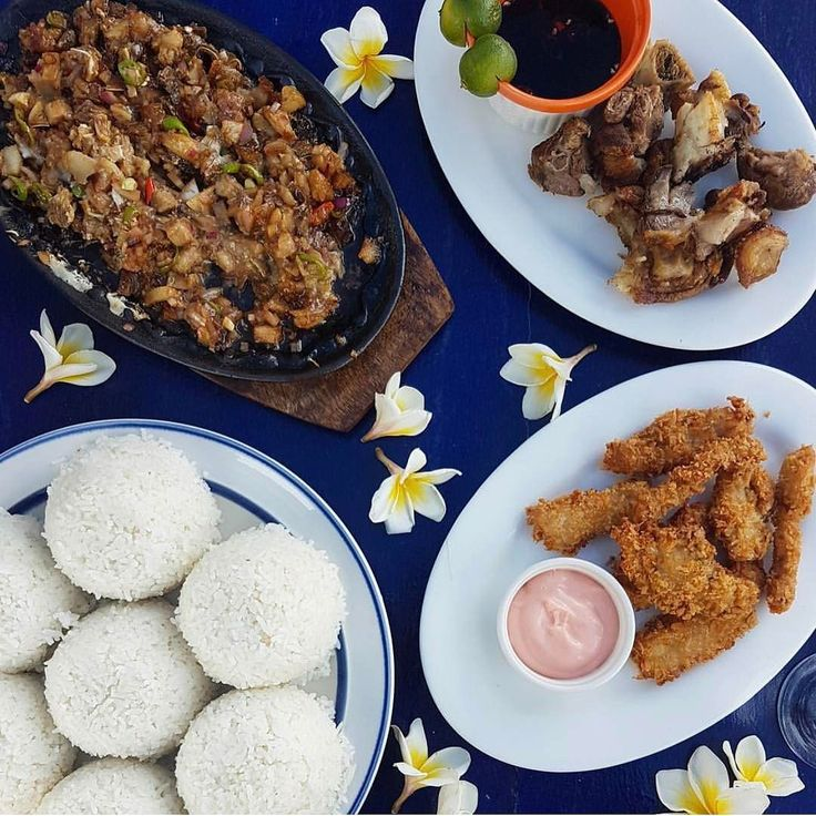 Keep using the hashtag #bookymanila to be reposted  Pangasinan  Pictured above: pork sisig crispy pata tuna fillet and rice  @ezgasm # #bookymanila  Tag your friends who love Filipino food