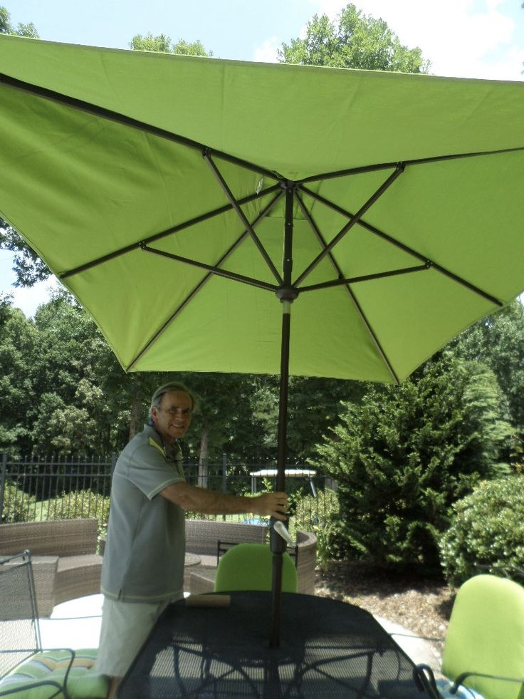 A rectangular patio umbrella provides great shade to our oval outdoor table.