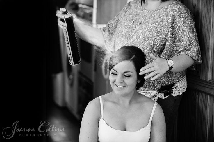 Chilham Castle Estate Wedding Photographer brides hairspray shot