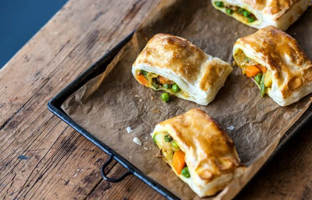 Vegetable puffs recipe with puff pastry, ginger, garlic, turmeric, chili powder, potato, carrot, green beans, peas, cumin and coriander.