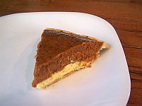 Double Layer Pumpkin Pie Recipe: Can't decide between pumpkin pie or cheesecake? This recipe means you don't have to!