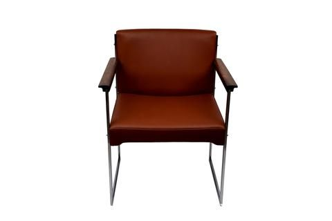 A rosewood/chrome metal armchair by Illum Wikkelsø upholstered with brown aniline leather