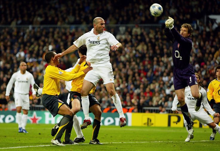 Jens Lehmann of Arsenal saves a header from Zinedine Zidane of Madrid during the UEFA Champions League Round of 16, First Leg match between Real Madrid and Arsenal at the Santiago Bernabeu Stadium on February 21, 2006 in Madrid, Spain. (Feb. 20, 2006 - Source: Richard Heathcote/Getty Images Europe)