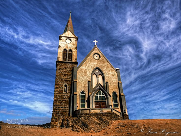 Felsenkirche in Luderitz - Pinned by Mak Khalaf Felsenkirche in Luderitz. Luderitz is a harbour town in southwest Namibia lying on one of the least hospitable coasts in Africa. Travel AfricaFelsenkircheGermanHistoryLuderitzNamibiaBlue SkyChurchDesertFanie HeymansOld ChurchPhotoPixSA.co.za by PhotoPixSA
