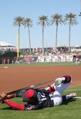 Cleveland Indians Francico Lindor stretches out before the opening game against the Cincinnati Reds at Goodyear Ballpark in Goodyear, Arizona on Feb. 25, 2017.  (Chuck Crow/The Plain Dealer)