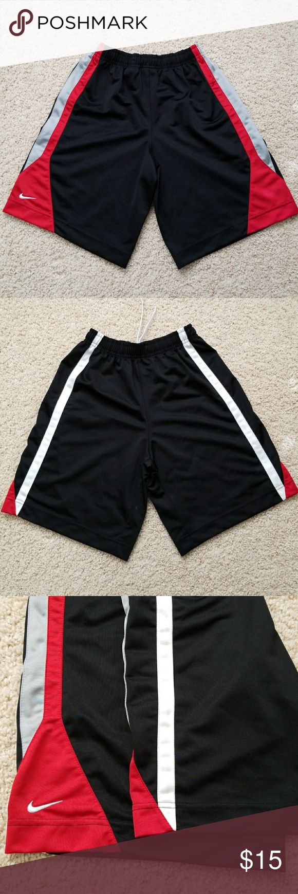 Boys Nike Shorts Boys Nike shorts perfect for sports like basketball and soccer and comfortable enough for everyday use. Multiple colors include black, red, white and Gray. Great condition. Size M 10-12 (boys) Nike Bottoms Shorts