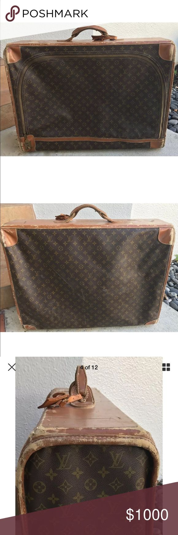 "Vintage 70's Louis Vuitton suitcase luggage Monogram Canvas with real leather trim Semi hard suitcase features one large zippered opening, two smaller inside pockets  brass feet  original luggage tag NO KEY for lock!   28"" X 21"" X 9""   card window inside that says Made for Louis Vuitton in the US by the French Company Lots of wear , looks vintage I did not try to clean it up Please note that vintage Louis Vuitton pieces often have different markings than current pieces.I guarantee that this…"