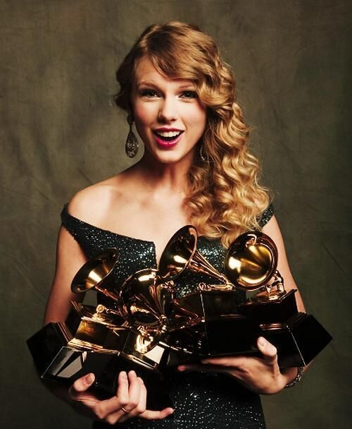 Photographed with her trophies for Album of the Year, Best Female Country Vocal Performance, Best Country Song, and Best Country Album at the 52nd Annual Grammy Awards, January 31, 2010