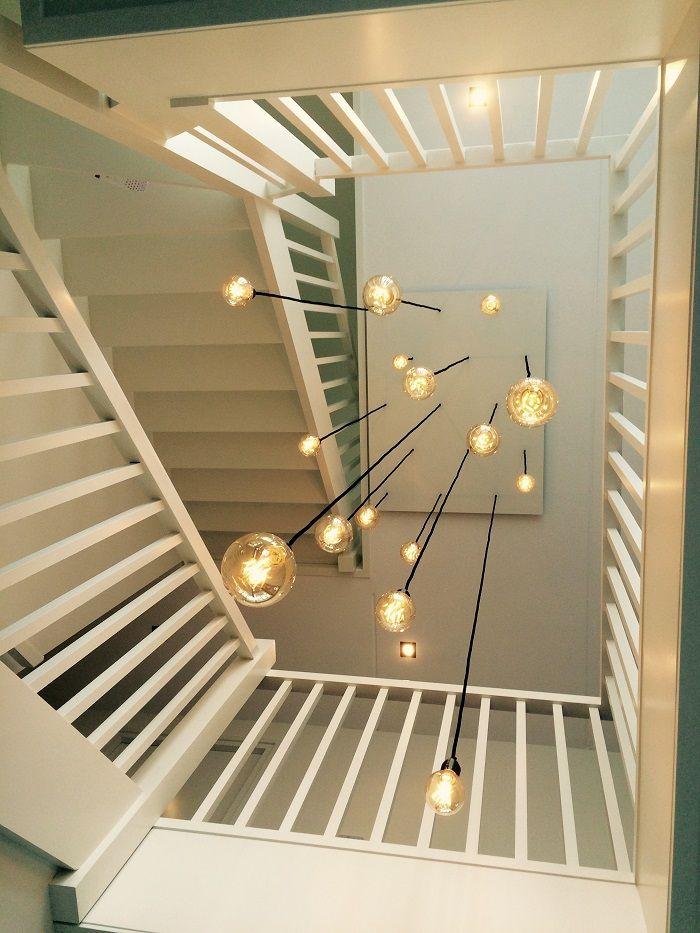 Vide lamp, lamp trappenhuis op maat. Gemaakt met 15 snoeren en dimbare Led filamentlampen.