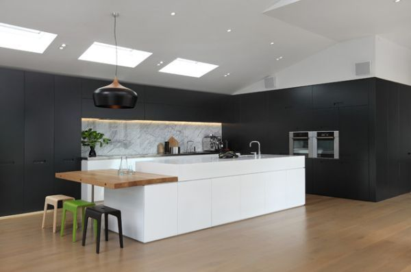 A hybrid kitchen island with a table extension on one side