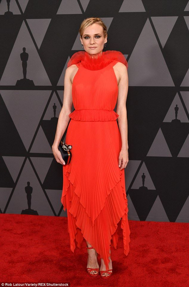 Red hot! Diane Kruger sizzled at the Governors Awards in a fiery red gown that flashed som...
