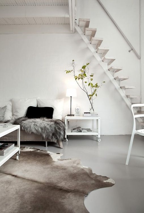 Polished concrete floor, white walls and minimalist furniture.