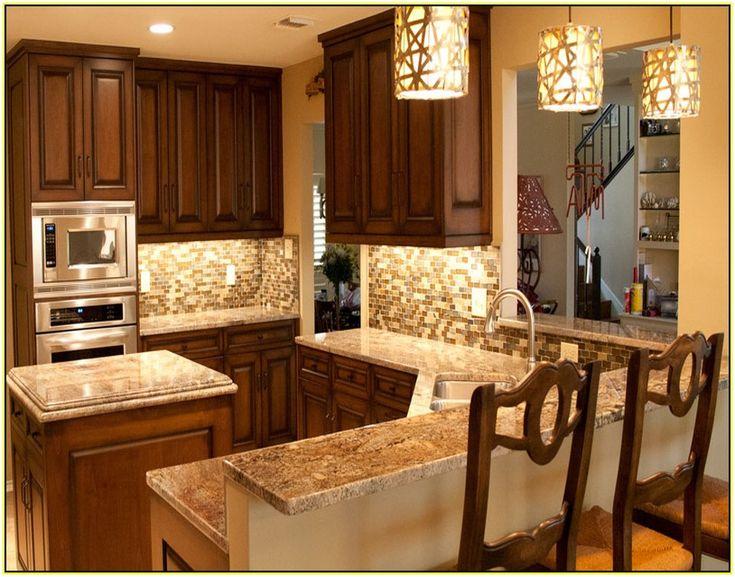 Delightful Kitchen Tile Backsplash Ideas With White Cabinets Part 5 - New Venetian Gold Granite Countertop With Tile Backsplash
