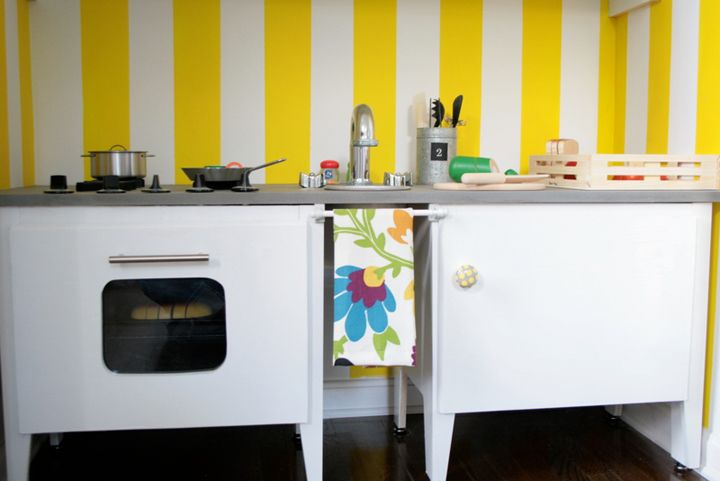play kitchen made from two nightstands, installed in an unused closet.
