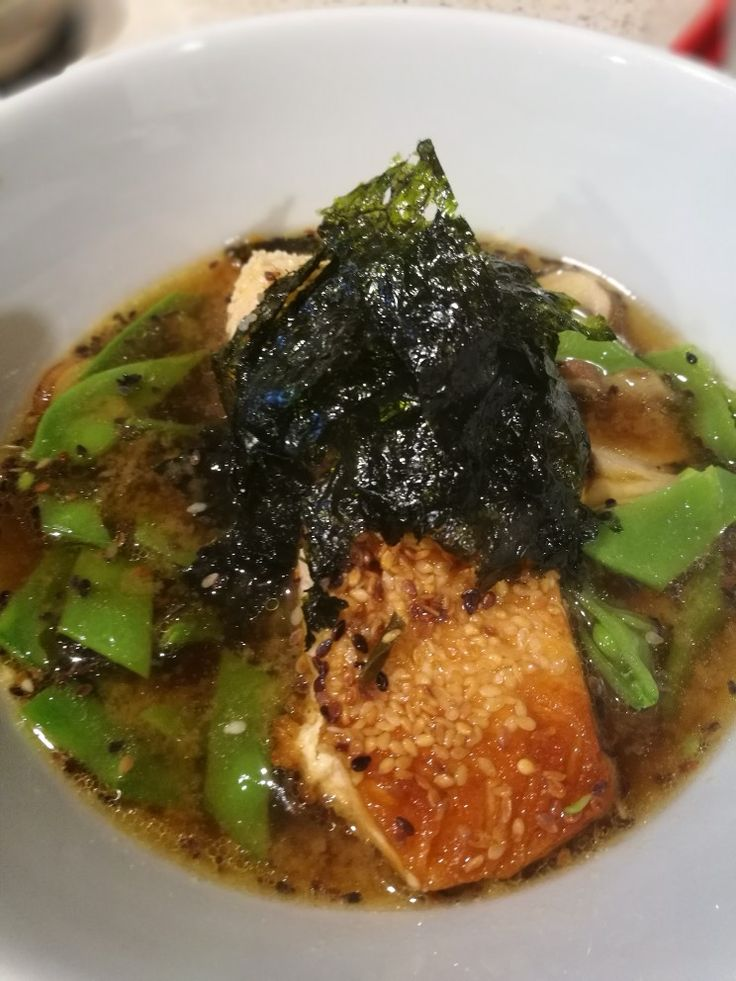 Sesame crusted salmon atop a snowpeas and mushroom miso soup