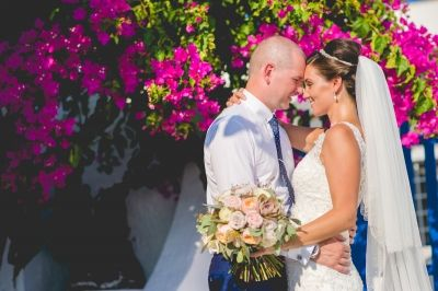 Mr an Mrs from real weddings in Santorini. See more... http://photographergreece.com/el/photography/wedding-stories/622-wedding-in-le-ciel,-santorini #wedding #bride #moments #MrandMrs #groom #kiss