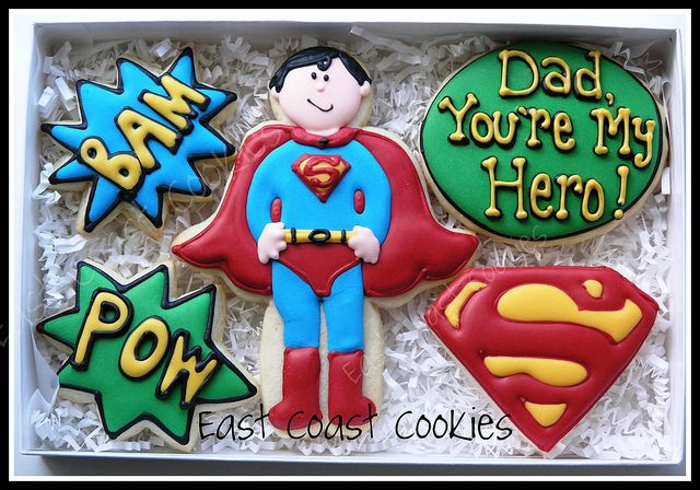 Dad, You're my Hero!    Superman cookies for a Super Dad!! This Superman turned out a little wonky (I had made 2).    *Other than the dude and the logo I was at a total loss for other extra cookies to put with the set. I didn't want to copy but was having a mental block (I didn't really want to make Superman cookies!) thus the Cartoony Action words are totally taken from a party that Callye recently made cookies for: www.thepartydress.net/2011/04/batman-a-superhero-birthday...