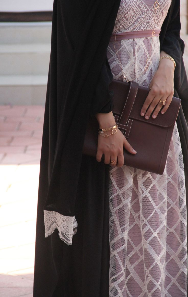 handbag and abaya Elegance but dont forget 2 wear a hijab that covers down to below your chest