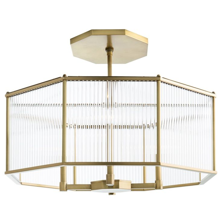 Hera Octagon Chandelier is a modern interpretation of the purity of form of Greek and Roman columns. Clear glass cylinders to create unique lighting, accenting the Vintage Silver or Antique Brass finish. Includes one 6inch and two 12 inch rods. Four 60 watt, 120 volt B10 type Candelabra base incandescent bulbs are required, but not included. 30 inch width x 12 inch height x 43.5 inch maximum length. UL listed. Damp rated.
